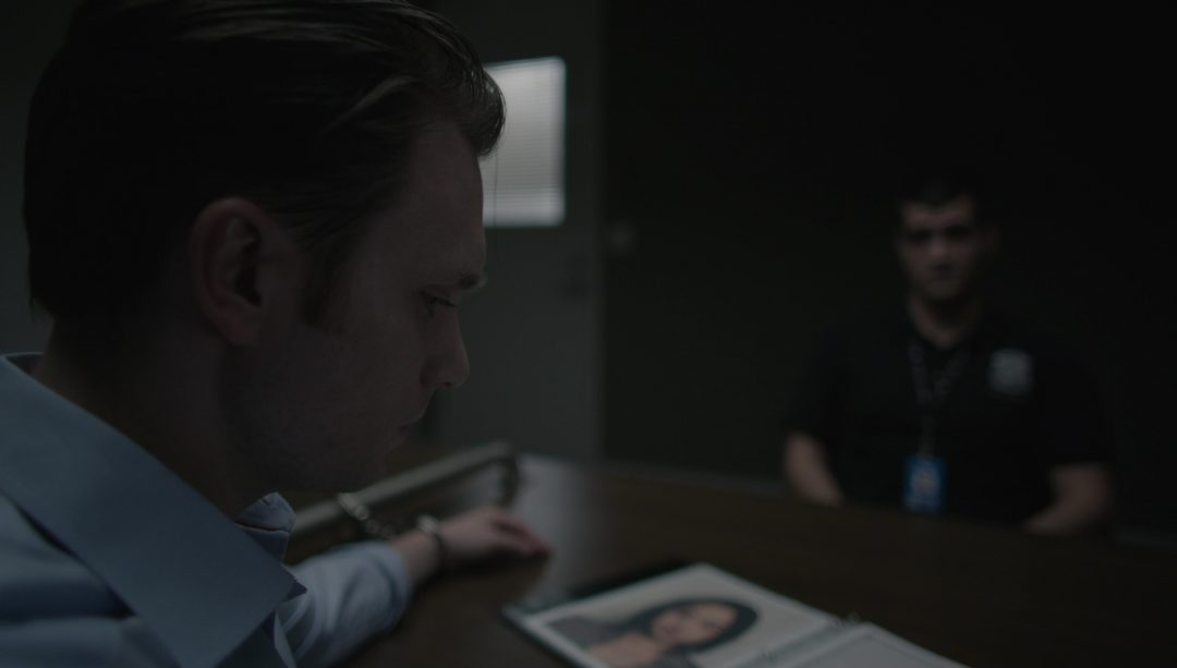 15 - Tyrell looks through a photo book of 'suspects' at the FBI with Agent Stanchek