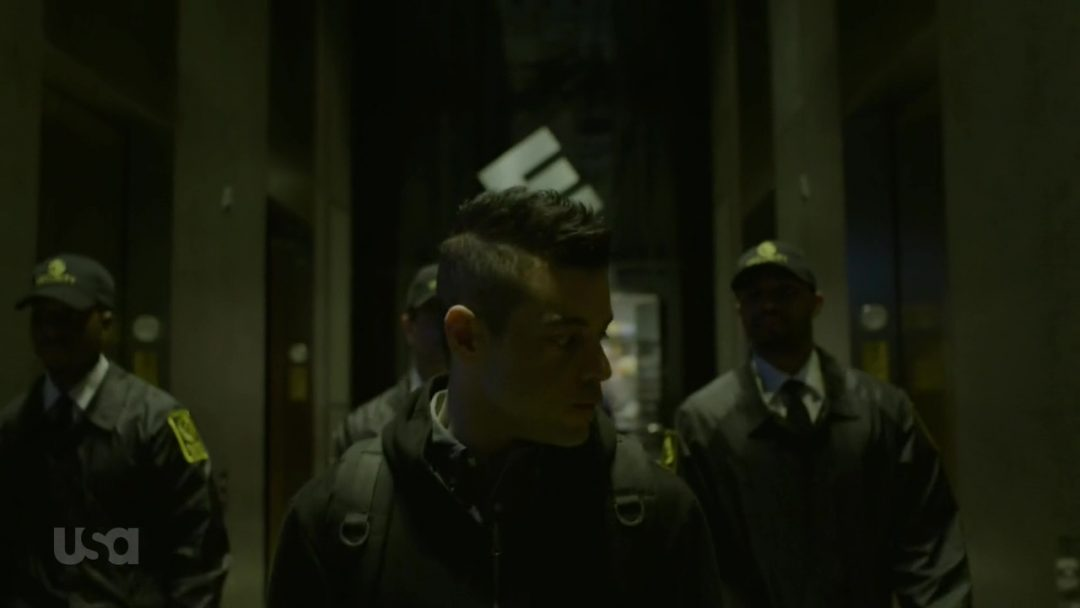 18 - Security finally catches up with Elliot and escorts him out of the building