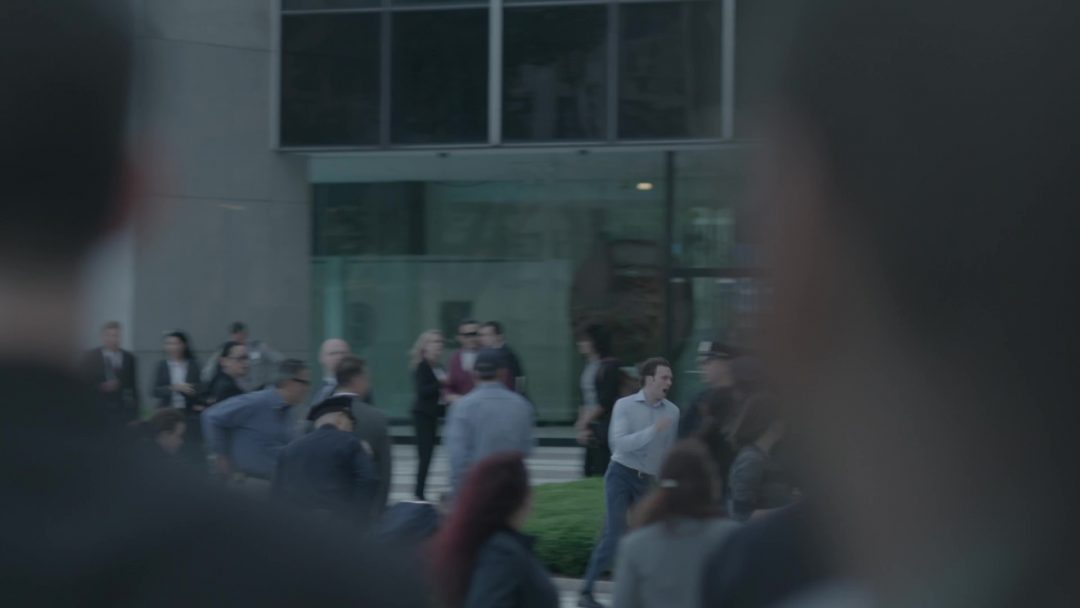 52 - Tyrell comes out of nowhere, running and yelling, in front of the FBI building