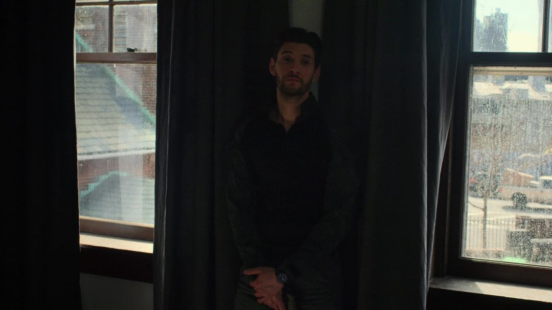 (13) Curtis opened the curtains, and Russo leans between the windows