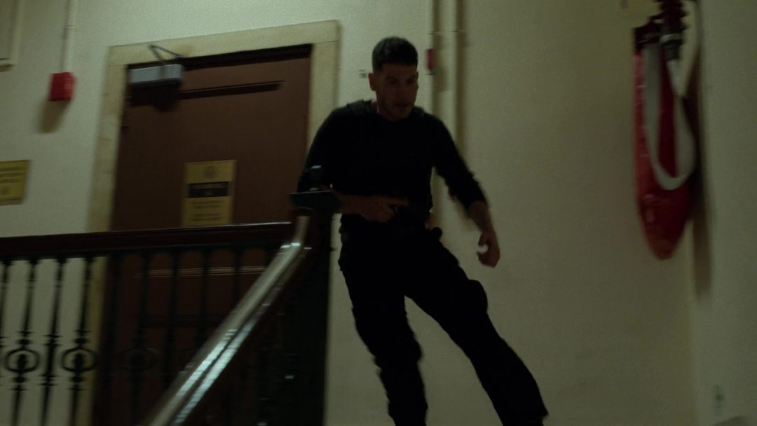 (20) The Punisher runs down the stairs to rescue Karen