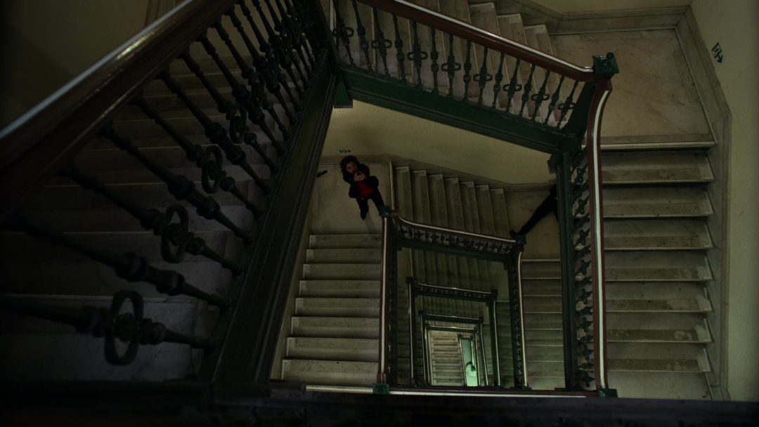 (23) Dinah looks upward at the attacker. Frank fell down the stairs, which saved him