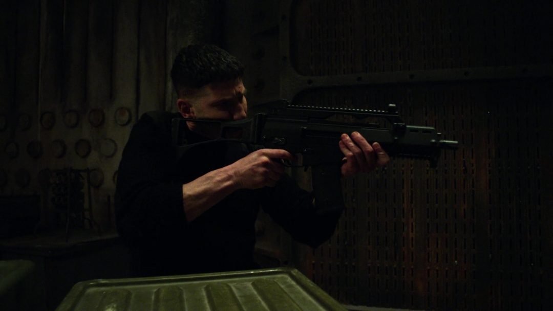 (23) The Punisher prepares for the assault team