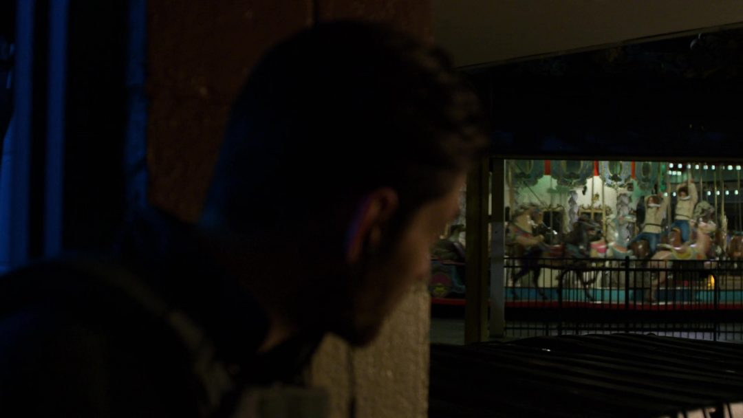 (24) Russo checks on his hostages while he talks to The Punisher on the phone