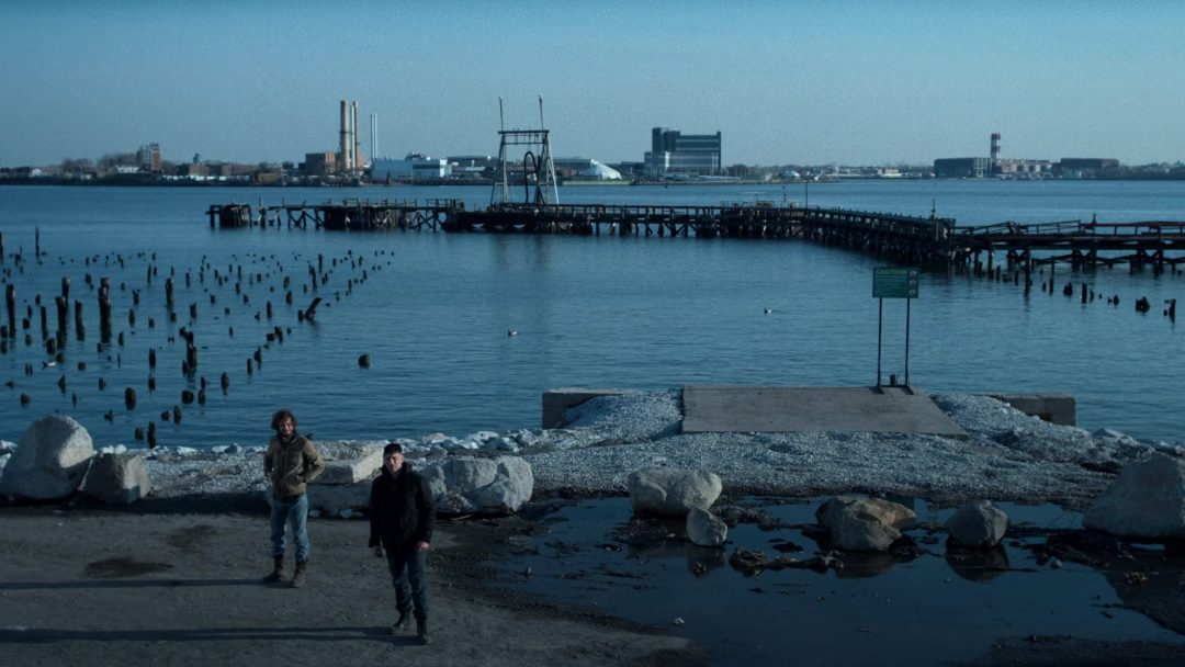 (3) The Punisher and Micro wait by the water for the hostage exchange