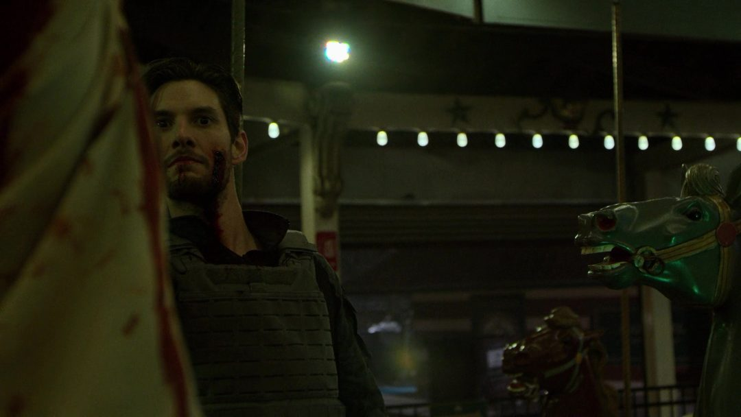(31) Russo threatens the hostages and makes the Punisher drop his gun