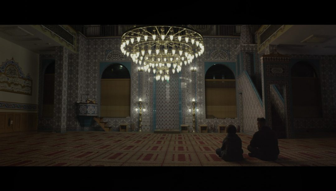 41 - Elliot and Mohammed sit together in the mosque